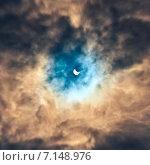 Купить «Солнечное затмение в облаках», фото № 7148976, снято 20 марта 2015 г. (c) Юрий Плющев / Фотобанк Лори