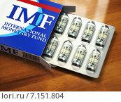 Купить «Concept of IMF tranches. Pack of dollars as pills in blister pack.», фото № 7151804, снято 4 апреля 2020 г. (c) Maksym Yemelyanov / Фотобанк Лори