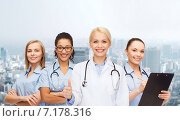 Купить «team or group of female doctors and nurses», фото № 7178316, снято 1 декабря 2013 г. (c) Syda Productions / Фотобанк Лори