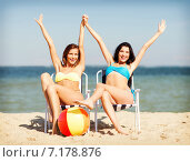 Купить «girls sunbathing on the beach chairs», фото № 7178876, снято 11 июля 2013 г. (c) Syda Productions / Фотобанк Лори