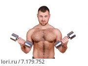 Купить «Muscular bodybuilder guy doing exercises with dumbbells isolated over white background», фото № 7179752, снято 22 марта 2019 г. (c) Александр Савченко / Фотобанк Лори