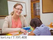 Купить «Pretty teacher helping pupil in classroom», фото № 7191408, снято 8 ноября 2014 г. (c) Wavebreak Media / Фотобанк Лори