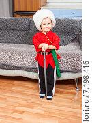 Купить «Улыбающийся мальчик в народном костюме и папахе с игрушечной шашкой», фото № 7198416, снято 18 января 2015 г. (c) Сергей Дубров / Фотобанк Лори