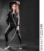 Купить «Young woman in a black clothes with a chain», фото № 7222648, снято 5 апреля 2015 г. (c) Art Konovalov / Фотобанк Лори