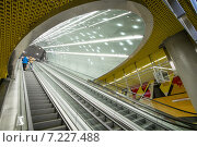 """Купить «Pictured: Њwiкtokrzyska metro station. The Warsaw Metro consists of two lines, the north–south Line 1 that links central Warsaw with its densely populated northern and southern suburbs, and the initial segment of the east-west Line 2 that opened on March 8, 2015. In 2009, the Warsaw Metro won two """"Metro Award"""" prizes in the categories of """"Special Merit Award for Commitment to the Environment"""" and """"Best Maintenance Programme"""". These were followed by the Most Improved Metro award in 2011.», фото № 7227488, снято 8 марта 2015 г. (c) BE&W Photo / Фотобанк Лори"""