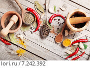 Купить «Colorful spices on a wooden background», фото № 7242392, снято 6 апреля 2015 г. (c) Майя Крученкова / Фотобанк Лори