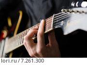Купить «Man with guitar during concert», фото № 7261300, снято 28 февраля 2012 г. (c) Elnur / Фотобанк Лори
