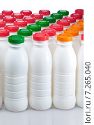 Купить «Молочные продукты в бутылках с цветными крышками», фото № 7265040, снято 21 марта 2012 г. (c) Куликов Константин / Фотобанк Лори