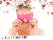 Купить «Composite image of attractive young blonde holding hearts over eyes», фото № 7265740, снято 11 декабря 2019 г. (c) Wavebreak Media / Фотобанк Лори