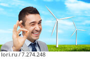 Купить «happy businessman in suit showing ok hand sign», фото № 7274248, снято 29 января 2015 г. (c) Syda Productions / Фотобанк Лори