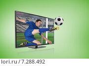 Купить «Composite image of football player in blue kicking ball through tv screen», фото № 7288492, снято 19 июня 2019 г. (c) Wavebreak Media / Фотобанк Лори