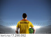 Купить «Composite image of australia football player holding ball», фото № 7290092, снято 19 июня 2019 г. (c) Wavebreak Media / Фотобанк Лори