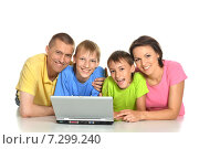 Купить «Friendly family in colored t-shirts», фото № 7299240, снято 15 августа 2013 г. (c) Ruslan Huzau / Фотобанк Лори