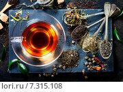 Купить «Чашка чая и ароматные сухие травы в ложках», фото № 7315108, снято 4 сентября 2014 г. (c) Наталия Кленова / Фотобанк Лори