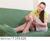 Купить «Girl treating feet with ointment», фото № 7318620, снято 18 августа 2019 г. (c) Яков Филимонов / Фотобанк Лори