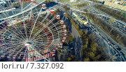 Купить «Колесо обозрения на ВДНХ, снятое с квадрокоптера», фото № 7327092, снято 24 февраля 2020 г. (c) Андрей Родионов / Фотобанк Лори
