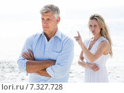 Купить «Upset couple having a disagreement», фото № 7327728, снято 22 октября 2014 г. (c) Wavebreak Media / Фотобанк Лори