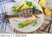 Купить «sea bream fish on plate», фото № 7328024, снято 22 марта 2015 г. (c) Tatjana Baibakova / Фотобанк Лори