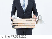 Купить «Businessman holding box of his things», фото № 7339220, снято 4 декабря 2014 г. (c) Wavebreak Media / Фотобанк Лори