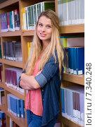 Купить «Pretty student in the library», фото № 7340248, снято 23 ноября 2014 г. (c) Wavebreak Media / Фотобанк Лори
