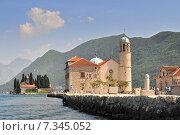 Купить «Our Lady of the Rock island and Church in Perast on shore of Boka Kotor bay (Boka Kotorska) Montenegro Europe.», фото № 7345052, снято 25 июня 2019 г. (c) BE&W Photo / Фотобанк Лори