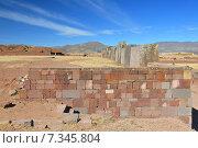 bolivia - tiwanaku pyramidBolivia, Tiwanaku, Walls Around the Temple Kalasasaya, background Pyramid. Стоковое фото, агентство BE&W Photo / Фотобанк Лори