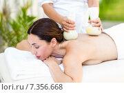 Купить «Brunette having massage with herbal compresses», фото № 7356668, снято 29 января 2015 г. (c) Wavebreak Media / Фотобанк Лори