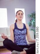 Купить «Fit woman doing yoga on mat», фото № 7359080, снято 18 февраля 2015 г. (c) Wavebreak Media / Фотобанк Лори
