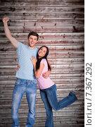 Купить «Composite image of young couple cheering at camera», фото № 7367292, снято 27 февраля 2020 г. (c) Wavebreak Media / Фотобанк Лори