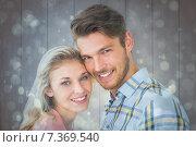 Купить «Composite image of attractive couple smiling at camera», фото № 7369540, снято 22 октября 2018 г. (c) Wavebreak Media / Фотобанк Лори