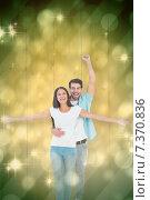 Купить «Composite image of happy casual couple cheering together», фото № 7370836, снято 21 апреля 2019 г. (c) Wavebreak Media / Фотобанк Лори