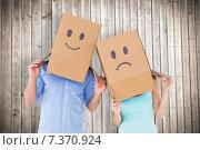 Купить «Composite image of couple wearing sad face boxes on their heads», фото № 7370924, снято 21 августа 2018 г. (c) Wavebreak Media / Фотобанк Лори