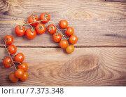 Купить «cherry tomatoes on rustic wooden background», фото № 7373348, снято 22 апреля 2015 г. (c) Майя Крученкова / Фотобанк Лори