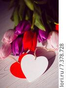 Купить «Bunch of tulips and heart card», фото № 7378728, снято 27 января 2015 г. (c) Wavebreak Media / Фотобанк Лори