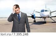 Купить «businessman over airplane on runway background», фото № 7395248, снято 15 марта 2014 г. (c) Syda Productions / Фотобанк Лори