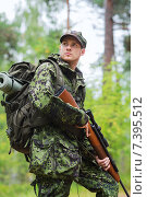 Купить «young soldier or hunter with gun in forest», фото № 7395512, снято 14 августа 2014 г. (c) Syda Productions / Фотобанк Лори
