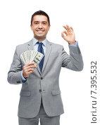 Купить «smiling businessman with american dollar money», фото № 7395532, снято 29 января 2015 г. (c) Syda Productions / Фотобанк Лори