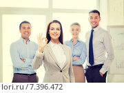 Купить «smiling businesswoman showing ok-sign in office», фото № 7396472, снято 5 апреля 2014 г. (c) Syda Productions / Фотобанк Лори