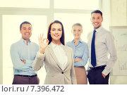 Купить «smiling businesswoman showing ok-sign in office», фото № 7396472, снято 5 апреля 2014 г. (c) Syda Productions / Фотобанк Лори