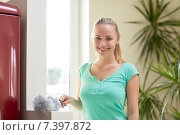 Купить «happy woman with duster cleaning at home», фото № 7397872, снято 25 января 2015 г. (c) Syda Productions / Фотобанк Лори