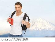 Купить «happy young man with backpack and book travelling», фото № 7398260, снято 8 апреля 2012 г. (c) Syda Productions / Фотобанк Лори