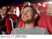 Купить «happy young man watching movie in theater», фото № 7398560, снято 19 января 2015 г. (c) Syda Productions / Фотобанк Лори