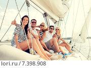 Купить «smiling friends sitting on yacht deck», фото № 7398908, снято 13 июля 2014 г. (c) Syda Productions / Фотобанк Лори