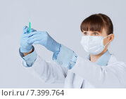 Купить «female doctor holding syringe with injection», фото № 7399764, снято 10 апреля 2013 г. (c) Syda Productions / Фотобанк Лори