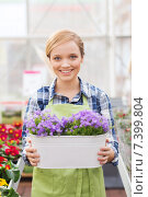 Купить «happy woman holding flowers in greenhouse», фото № 7399804, снято 25 февраля 2015 г. (c) Syda Productions / Фотобанк Лори