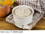 Купить «Mayonnaise in a bowl with eggs on wooden background», фото № 7404628, снято 10 марта 2015 г. (c) Tatjana Baibakova / Фотобанк Лори
