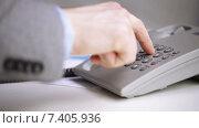 Купить «close up of businessman dialing phone number», видеоролик № 7405936, снято 4 апреля 2015 г. (c) Syda Productions / Фотобанк Лори