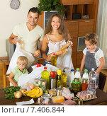 Купить «Cheerful family of four with bags of food», фото № 7406844, снято 17 июля 2018 г. (c) Яков Филимонов / Фотобанк Лори