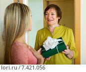 Купить «Mature neighbor presenting gift to young girl», фото № 7421056, снято 23 мая 2014 г. (c) Яков Филимонов / Фотобанк Лори