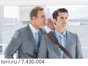 Купить «Businessman telling secret to his colleague», фото № 7430004, снято 14 марта 2015 г. (c) Wavebreak Media / Фотобанк Лори